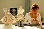 Female worker, woman modelling a porcelain figure in a Porcelain Factory, Sitzendorf, Thuringia, Germany