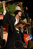 An actor, dressed up as Martin Luther, protesting on the carousel at a medieval festival, Luther Festival, Eisenach, Germany