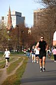 People jogging on the Esplanade, Back Bay, Boston, Massachusetts, USA