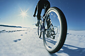 Mountainbiker in snow, 5 Lakes District, Upper Bavaria, Germany