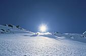 Skiers in backlight, Zuers, Austria
