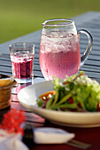 Close up of a refreshing drink and salad, near Uluwatu, Bali, Indonesia