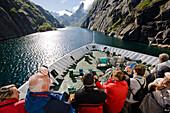 Tourists on board a Hurtigruten ship, Fiord, Trollfjord, Austvagoya Island, Lofoten, Norway