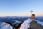 Mount Geigelstein with summit cross and chapel, view to Wilder Kaiser range, Chiemgau Alps, Upper Bavaria, Bavaria, Germany