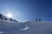 Two back-country skiiers on snow cornice, Tschachaun, Lechtal Alps , Vorarlberg, Austria