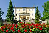 Castle Emsburg with bed of roses, Salzburg, Austria