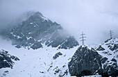 High-voltage power line across Hagengebirge range near notch Torscharte, Berchtesgaden range, Salzburg, Austria