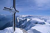 Summit cross on mount Hoher Goell, view to Tennen Range and Dachstein range, Berchtesgaden Alps, Upper Bavaria, Bavaria, Germany