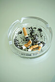 Cigarette butts in an ash tray, Close-up