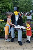 Young Girl with Lego Gentleman Hans Christian Andersen, Legoland, Billund, Central Jutland, Denmark