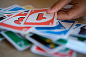 Person playing Uno, Sylt island, Schleswig-Holstein, Germany