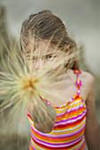 Girl (5 years) looking at camera, Amrum island, North Frisian Islands, Schleswig-Holstein, Germany