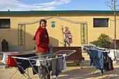 Washing day, a woman, in front of the pilgrims lodgings, Najera, Camino de Santiago, La Rioja, Spain
