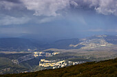 Dramatic sky and landscape from mount Arangoiti towards canyon Foz de Arbayun and river Río Salazar, Navarra, Spain
