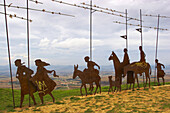 Landscape with metal sculpture of a pilgrimage group from Vicenti Gallete, in the Sierra del Perdon, at Perdon, Pyrenees, Navarra, Spain