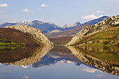 Landscape of a reservoir with reflection, Embalse de Porma, snow covered mountains in the background, Codillera Cantabrica, Castilla León, Spain