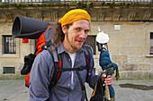A man, pilgrim finally at his destination, St. James Way, Praza de Cervantes, Santiago de Compostela, Galicia, Spain
