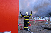 Firefighter throwing a hose, Hanover, Lower Saxony, Germany