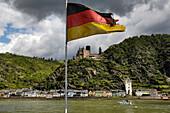 German flag in wind, Katz castle in background, St. Goarshausen, Rhineland-Palatinate, Germany