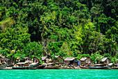 Boats and houses on the beach, Chao Naam, Moken, village, Surin Islands Marine National Park, Ko Surin, Phang Nga, Thailand