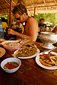 Young man eating Thai food, set menu, Surin Islands Marine National Park, Ko Surin, Thailand
