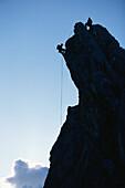 Climbers on mount Alpspitze, Garmisch Partenkirchen, Bavaria, Germany