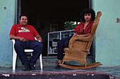 Woman sitting in a rocking chair, Granada, Nicaragua, Central America