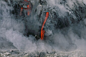 Flow of Lava with vapour, Pu'u O'o Crater, flowing into the sea near Kamoamoa, Kilauea, Big Island, Hawaii, USA