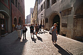People strolling on a cobbled alley in the Old Town, Regensburg, Upper Palatinate, Bavaria, Germany