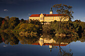 Calm waters of river Regen reflecting the former Cistercian abbey of Walderbach , Bavarian Forest, Upper Palatinate, Bavaria, Germany
