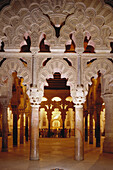 Artful horseshoe arches and columns in the Villaviciosa chapel of the Great Mosque Mezquita in Cordoba, Andalusia, Spain