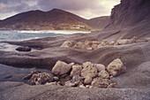 Rocky beach, Bay near Agua Amarga, Cala del Plomo, Parque Natural Cabo de Gata, Andalusia, Spain