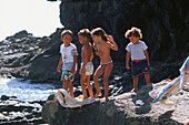 Children playing on a black sanded beach, Ajuy, Fuerteventura, Canary Islands, Spain