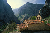 Small church of Camarmena on a shoulder of the Garganta del Cares gorge, Picos de Europa National Park, Asturias, Northern Spain