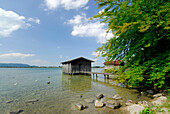 Boat huts with landing stage at shore of lake Kochelsee, Upper Bavaria, Bavaria, Germany