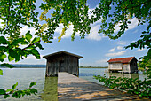Boathouses with landing stages at lake Kochelsee, Upper Bavaria, Bavaria, Germany