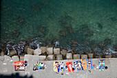 Overhead of Sunbathing Teenagers, Sorrento, Campania, Italy