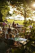 Guests in the garden of restaurant Buscharner, Buchscharn, Lake Starnberg, Bavaria, Germany