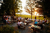 Guests in beer garden Buscharner, Muensing, Lake Starnberg, Bavaria, Germany