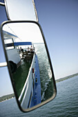 View into a mirror of a excursion boat on Lake Starnberger, Bavaria, Germany
