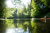 Two people, participants on the Mangfall river, kayak weekend for beginners on the Mangfall river, Upper Bavaria, Germany