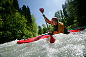 Man in a kayak, kayak weekend for beginners on the Mangfall river, Upper Bavaria, Germany