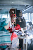 Female singer in traditional Russian costume, tour boat on Newa river, St. Petersburg, Russia