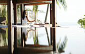 Woman meditating by a pool, Reflection, Relaxation, Health, Wellness
