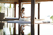 Woman meditating by a pool, Reflection in the water, Relaxation, Wellness, Health