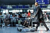 Businessman at airport, Frankfurt Airport, Frankfurt, Hesse, Germany