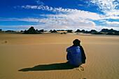 Berber People cowering in the sand, Tassili N' Ajjer, algerian Sahara, Algeria, Africa