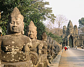 Statues at temple complex of Angkor Thom, South gate. Angkor. Cambodia