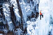 Ice climber on frozen waterfall, Seydisfjördur, Austurland, Iceland