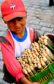 Kid selling crayons in the streets. Quito. Ecuador